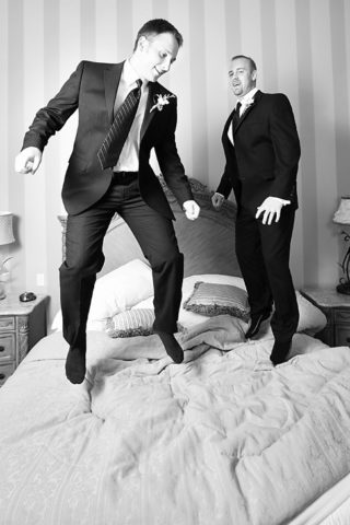 Best Man Duties - here the best man and groom are jumping on the bed to release energy!