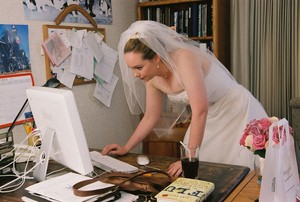 bride-checking-wedding-planning-websites-by-madprime.jpg