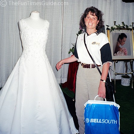 Looking at wedding dresses at a bridal show. photo by Lynnette at TheFunTimesGuide.com
