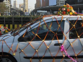 Fresh flowers and silk flowers make great wedding car decorations!