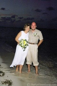 Our wedding on the beach. We're both wearing fun, casual clothes. photo by Lynnette at TheFunTimesGuide.com