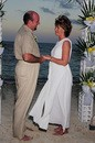 Jim and Lynnette's wedding ceremony - exchanging vows oceanside on Cable Beach in the Bahamas