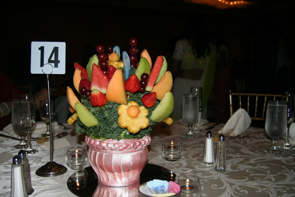 Small baskets of fruit that match your wedding colors make an entire